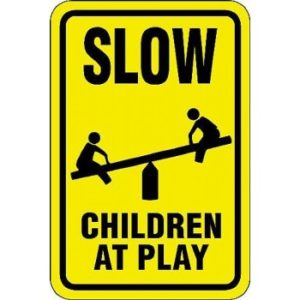 slow_children_at_play_w-_teeter-totter_symbol_sign-933-1